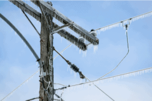 Power pole in minnesota freezing over in winter