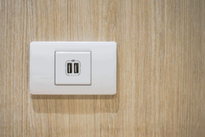 Empty USB outlet on wooden wall background