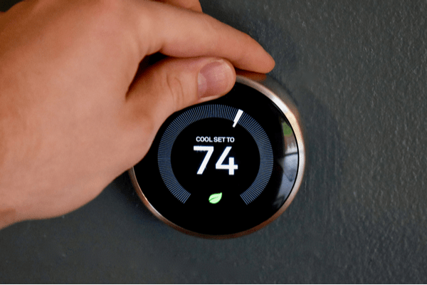 Hand adjusting temp on Nest Learning Thermostat