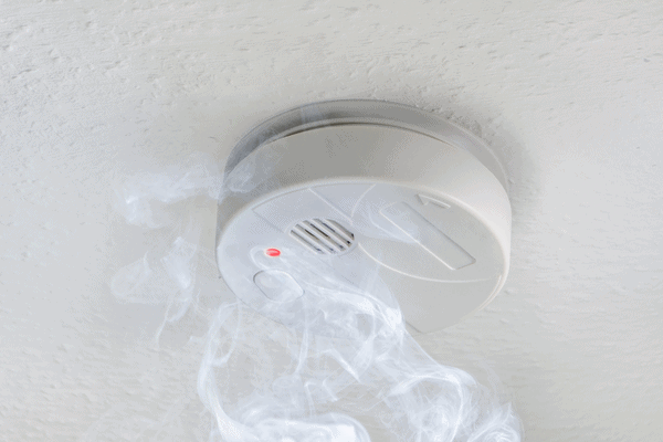 Smoke rising up into a smoke detector's chamber, triggering the alarm